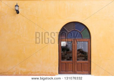 Wood Window On Yellow Cement Mortar Wall