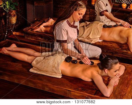 Couple  having stone massage. Ayurveda lastone spa treatment.