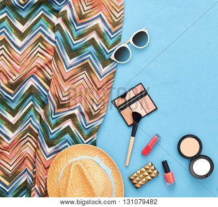 Fashion. Fashion woman essentials.Unusual fashion overhead, top view. Fashion clothes, cosmetics,makeup accessories fashion set.Urban fashion summer colorful outfit.Stylish handbag clutch, sunglasses.