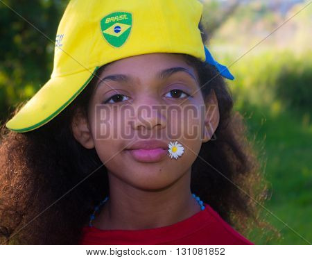 Brazilian girl with the happy brazil hat for the arrival of world sports festival the Games