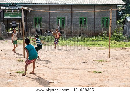 MYANMAR- INLE 15 OCT 2014: Kids playing football in inle 14 oct 2014 from Myanmar.