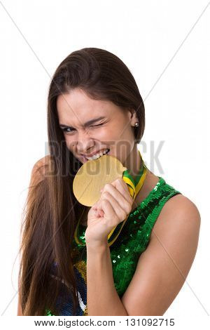 Young Brazilian woman fan holding a medal on white background