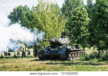 NITRA SLOVAK REPUBLIC - MAY 21: Reconstruction of the Second World War operations between Red and German army russian war tank shoots to the enemy german combat positions on May 21 2016 in Nitra Slovak Republic.