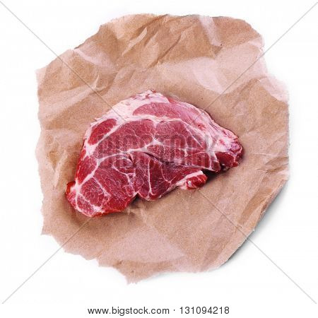 Row pork steak with paper, isolated on white