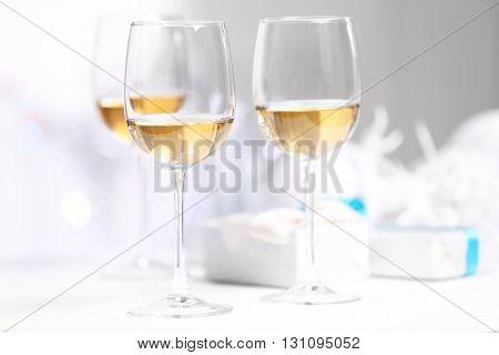 Wineglasses on light blurred background