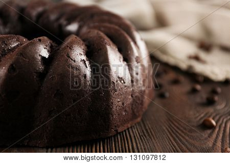 Chocolate cake on wooden background, closeup
