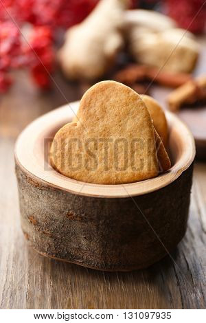 Heart shaped biscuits in wooden bowl, closeup