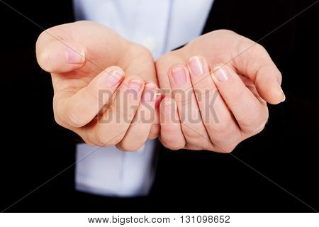 Business woman's hands holding something