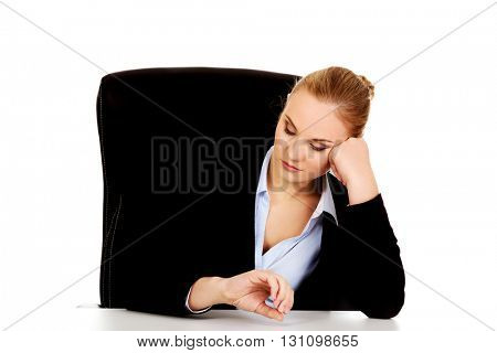 Tired business woman sitting behind the desk