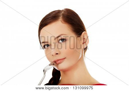 Young woman thinking what to eat