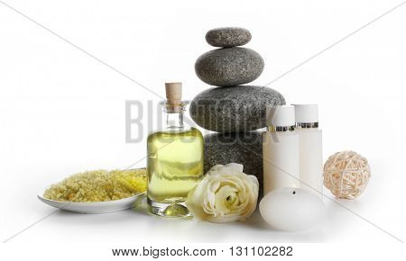 Spa still life with pebbles and oil isolated on white