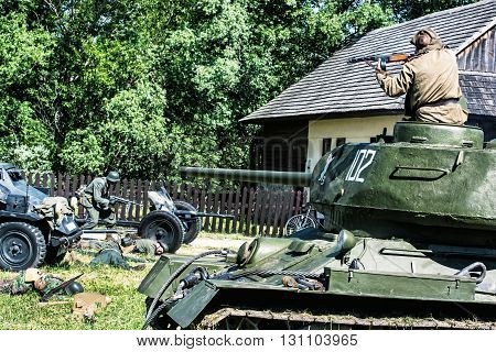 NITRA SLOVAK REPUBLIC - MAY 21: Reconstruction of the Second World War operations between Red and German army russian trooper kills german soldiers on May 21 2016 in Nitra Slovak Republic.
