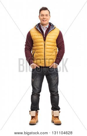 Full length portrait of a cheerful young man in casual winter clothes isolated on white background