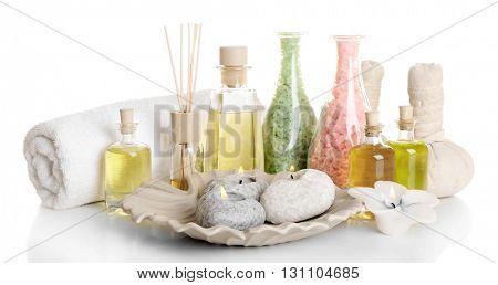 Spa treatment with essential oils isolated on white.
