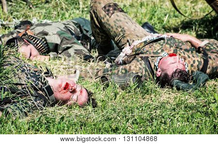 NITRA SLOVAK REPUBLIC - MAY 21: Reconstruction of the Second World War operations between Red and German army group of german dead soldiers on the grass on May 21 2016 in Nitra Slovak Republic.