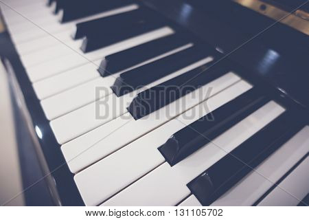 Close up of Piano keys with selective focus ,Filtered image processed vintage effect.