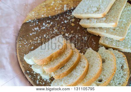 Sliced white bread on wood
