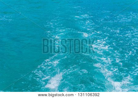 Trail on sea water surface behind boat
