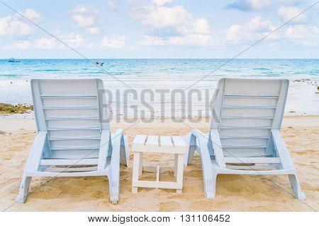 Beautiful beach chairs on tropical white sand beach