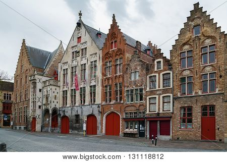 Street with historic houses in Bruges city center Belgium