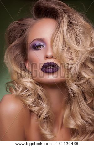 Fashion blonde woman with beautiful face and curly hair. Skin care concept