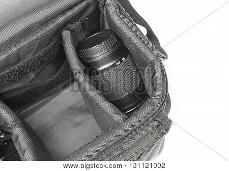 black camera bag on open have camera lens white background select focus Top view