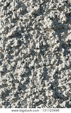 A rough stone textured wall for Background.