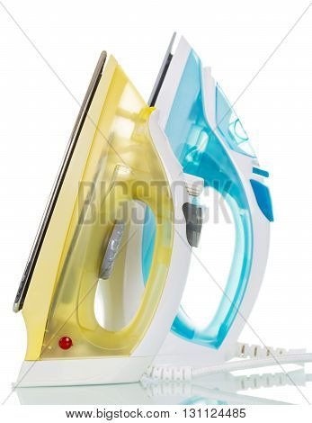 Modern steam irons isolated on white background.