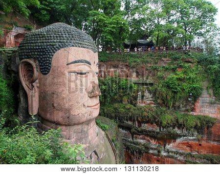 The 71m tall Giant Buddha (Dafo) carved out of the mountain in the 8th century CE in Leshan Sichuan province China
