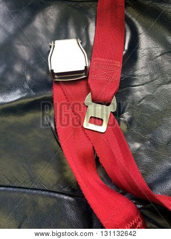 Red Safety belts on black leather seat