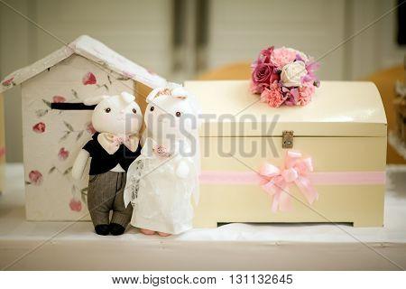 Wedding couple dolls on the reception desk