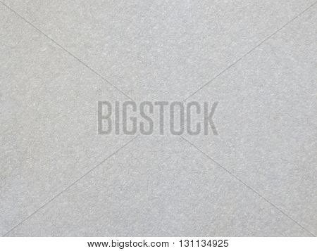 Closeup of a section of plain textured paper.