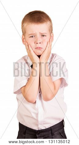 Unhappy boy covers his cheeks hands isolated on white background.