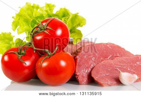 Pieces of fresh raw meat, tomatoes and lettuce isolated on white background.