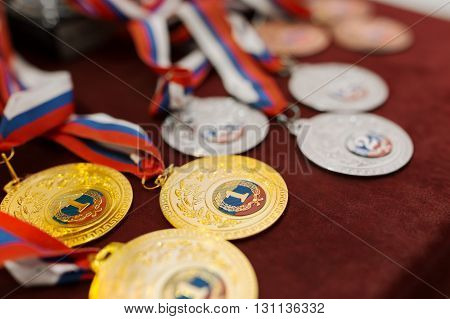 Vanquish the medals for the competition on table