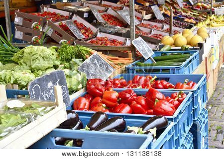 Fruit market with various fruits and vegetables. Fresh vegetables and fruits at a market stall. Colorful vegetable and fruits in a row with copy space.