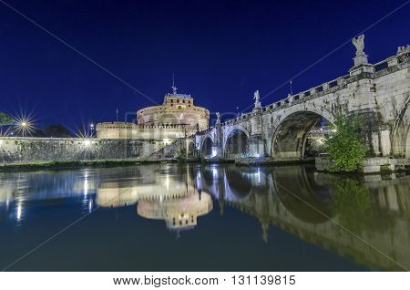 Italy, Rome, Ponte Sant'Angelo - Castel Sant'Angelo shot in the night from the tiber riverside