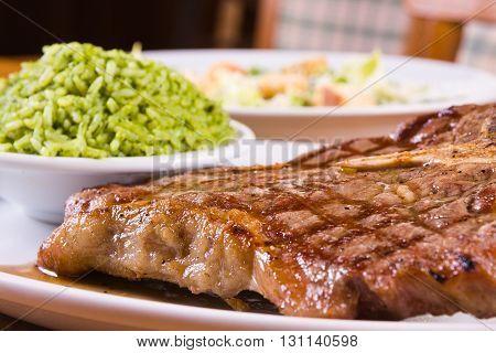Grilled Pork Fillet with brocolli rice and caesar salad