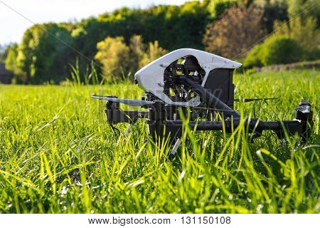 Dron Is Located In The Green Grass Before Takeoff