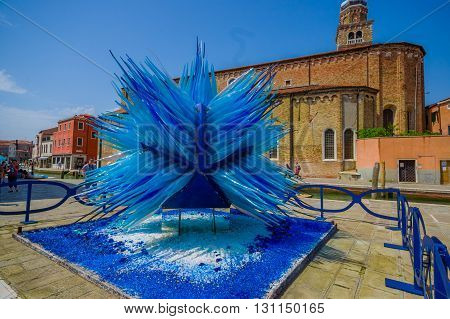 MURANO, ITALY - JUNE 16, 2015: Glass sculpture in the middle of Murano island, main manufacture job in blue.