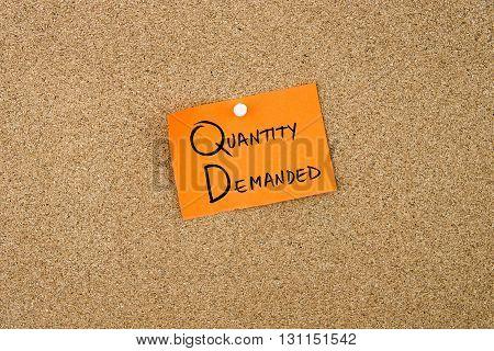 Quantity Demanded Written On Orange Paper Note