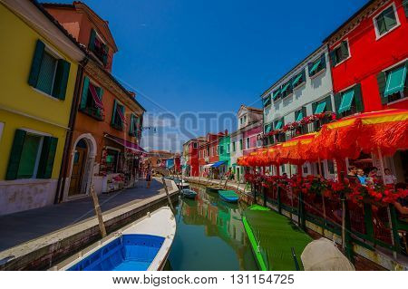 BURANO, ITALY - JUNE 14, 2015: Nice view from the bridge in Burano, water canal with colorfull houses on the sides.