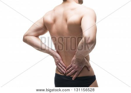 Man with backache. Pain in the human body. Muscular male body. Isolated on white background. Middle part of the body