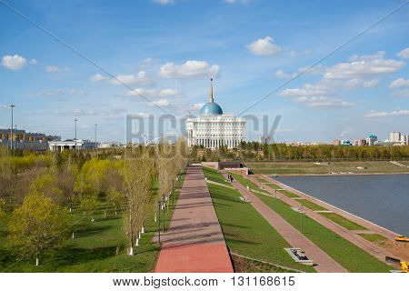 Astana, Kazakhstan - April 23, 2016: The photo depicts the city of Astana. In the center of the image residence of President Nursultan Nazarbayev - Akorda. Astana is the capital of the Republic of Kazakhstan. On the left in the photograph House of Ministr