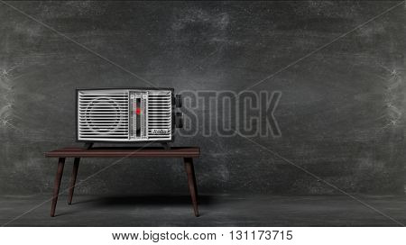 Antique radio transistor on table with blackboard background. 3D rendering