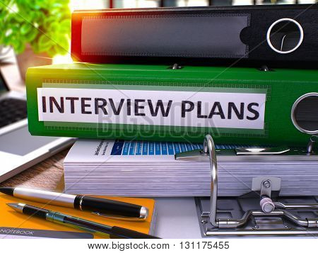 Green Office Folder with Inscription Interview Plans on Office Desktop with Office Supplies and Modern Laptop. Interview Plans Business Concept on Blurred Background. 3D Render.