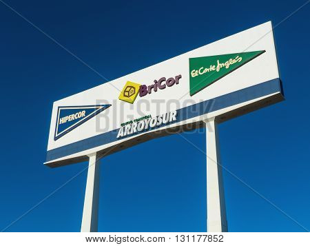 LEGANES MADRID SPAIN - FEBRUARY 20 2016: White billboard with some brands of El Corte Ingles. El Corte Ingles Hipercor Opencor in Arroyosur commercial center. El Corte Ingles is Spain's only remaining department store chain