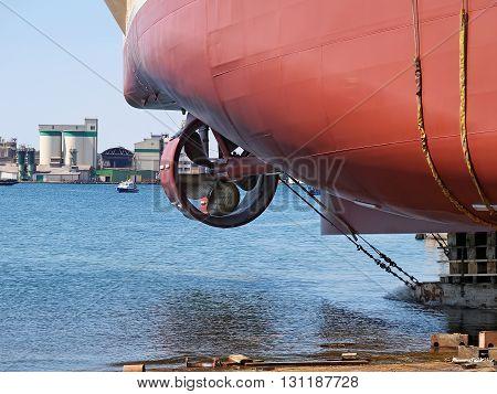new ship launching in shipyard, side view