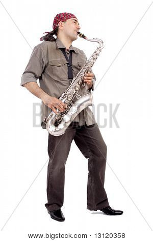 A man playing his wind instrument with expression.