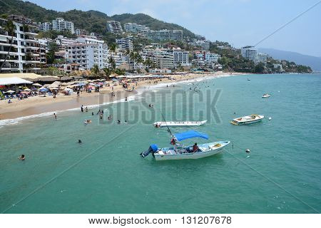 PUERTO VALLARTA MEXICO MAY 11 2016: Puerto Vallarta is popular tourists destination. Beautiful beaches and clear warm water of the North Pacific Ocean are attractive to swimmers all year.
